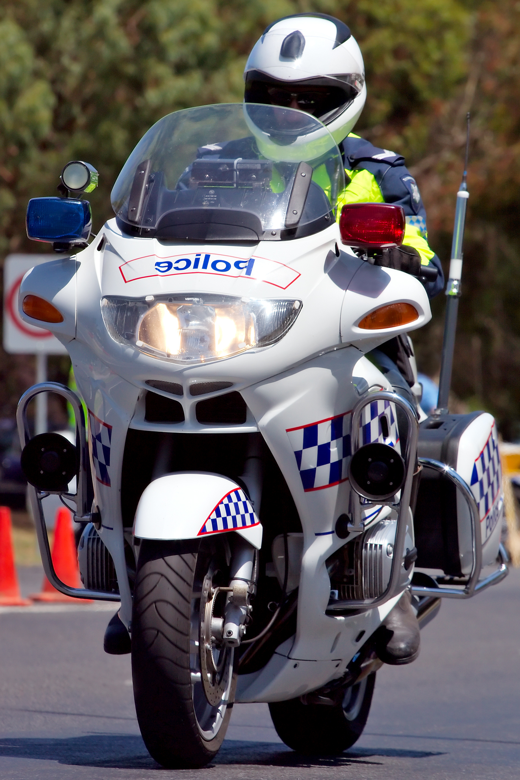 Police motorcycle with rider