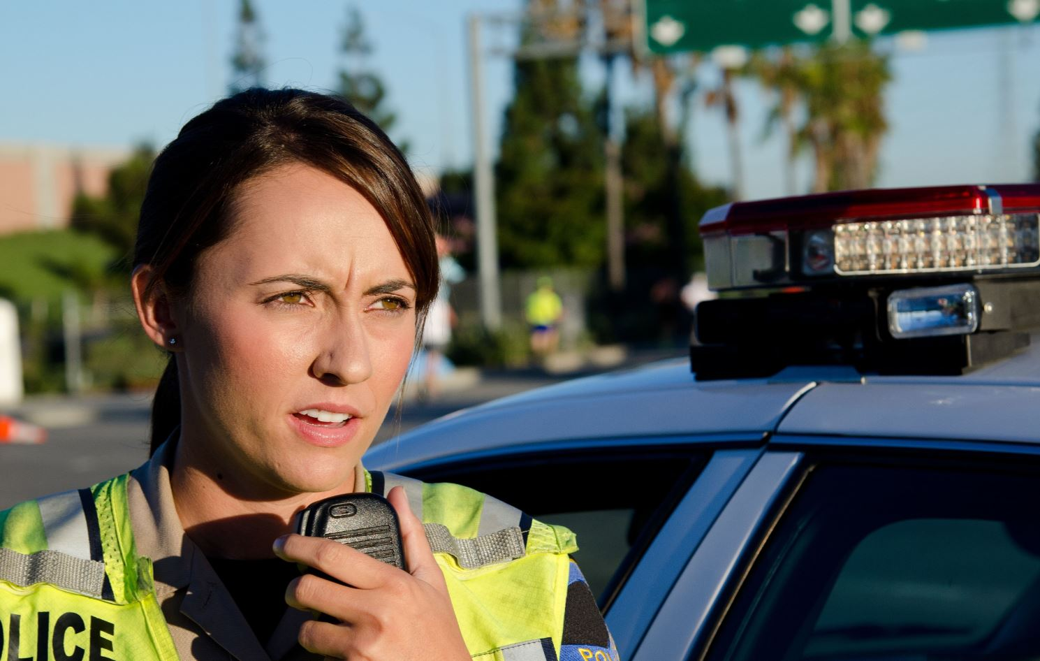 Police officer talking into a radio.-1