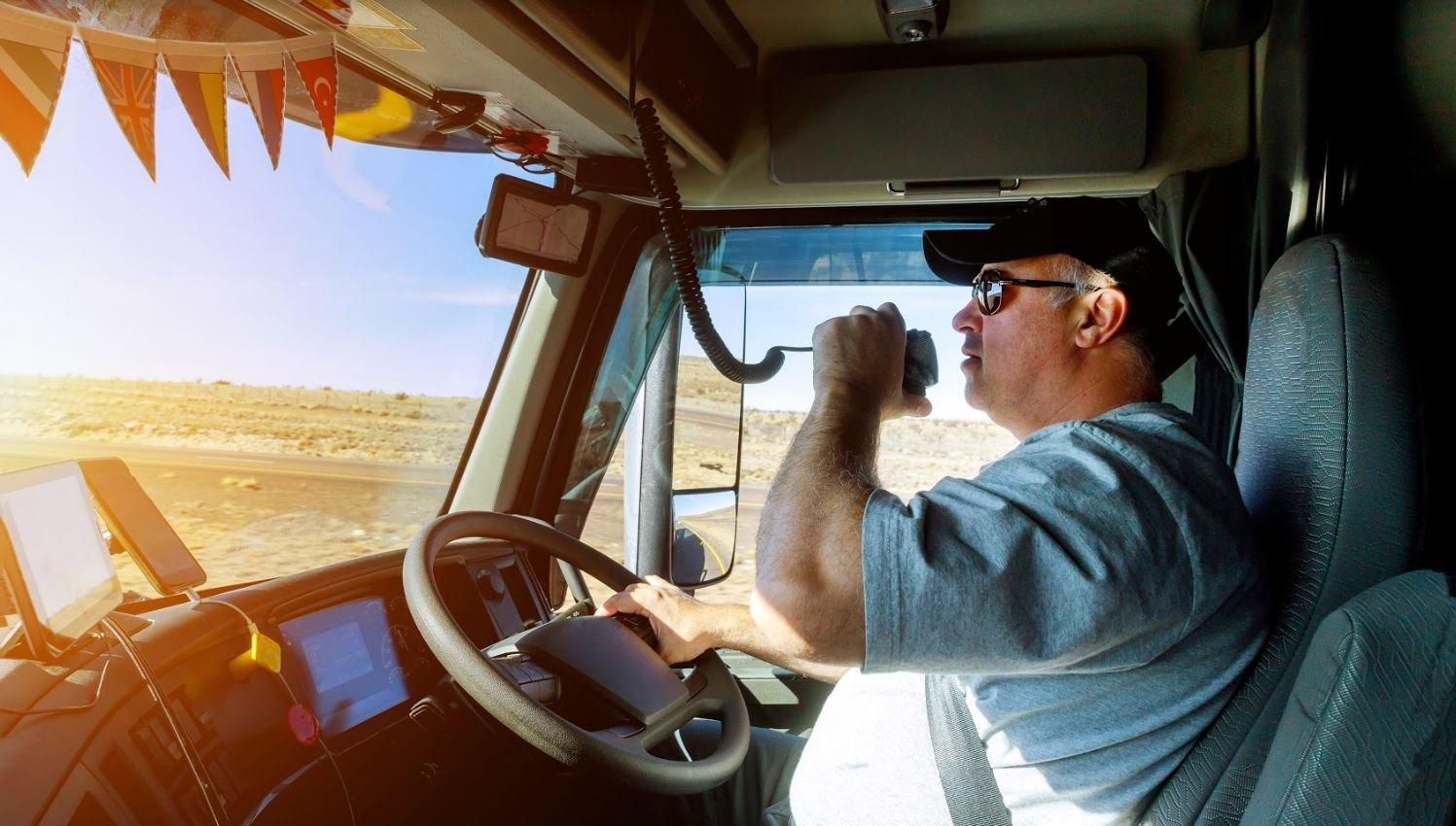 Truck driver driving on Austrlian highway.